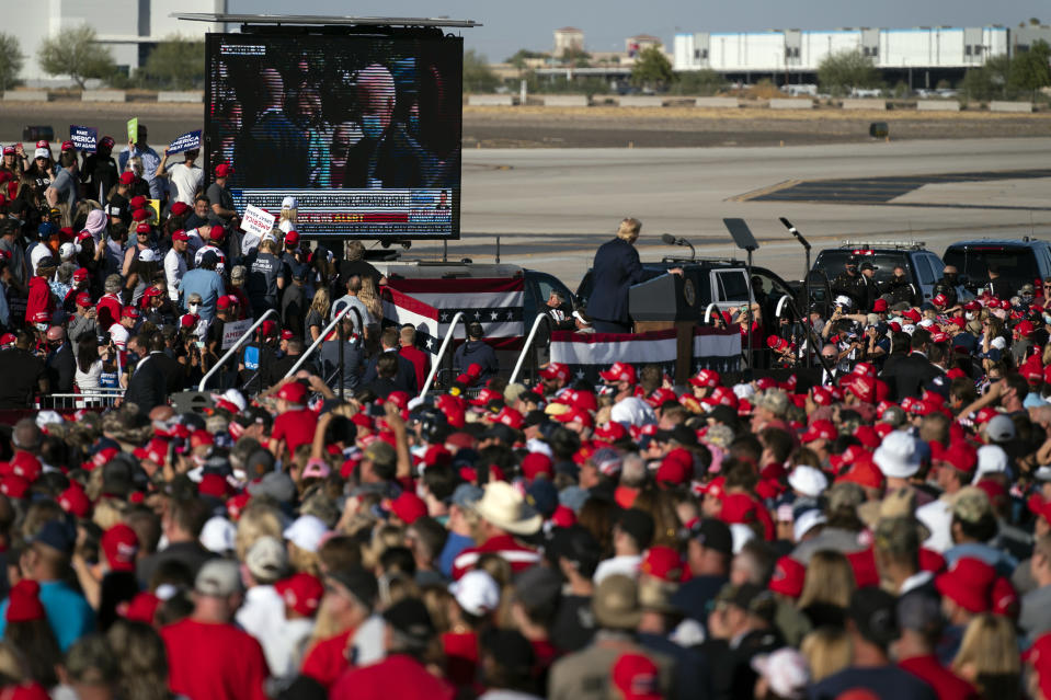 President Donald Trump plays a video of Democratic presidential candidate former Vice President Joe Biden during a campaign rally at Phoenix Goodyear Airport, Wednesday, Oct. 28, 2020, in Goodyear, Ariz. (AP Photo/Evan Vucci)