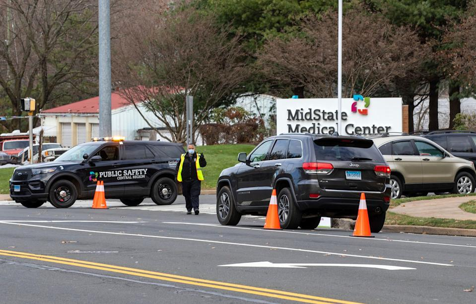 Cars wait in line at the entrance to MidState Medical Center in Meriden, Conn. to get a COVID-19 test on Thursday, Nov. 19, 2020.