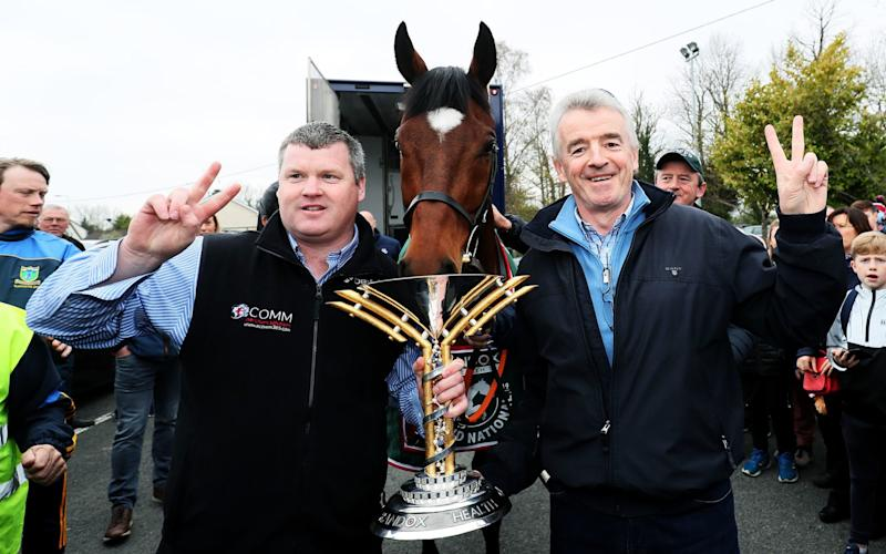 2019 Grand National Winner Tiger Roll with trainer Gordon Elliott (left), and owner Michael O'Leary  - PA