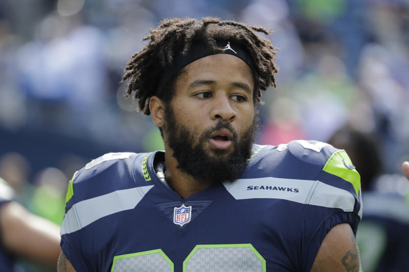 Earl Thomas stands on the field during warmups with the Seahawks before an NFL game in 2018.