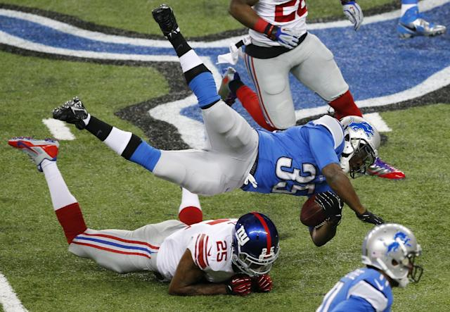 Detroit Lions running back Joique Bell (35) is upended by New York Giants free safety Will Hill (25) during the first quarter of an NFL football game, Sunday, Dec. 22, 2013, in Detroit. (AP Photo/Paul Sancya)