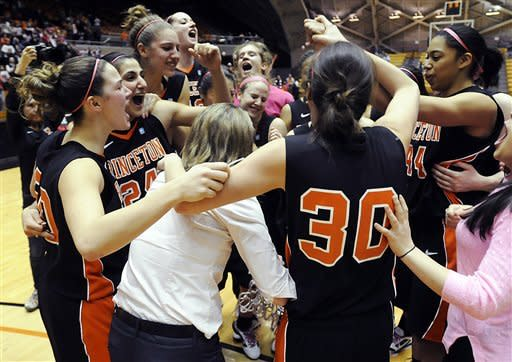 Princeton players celebrate their 94-57 victory over Dartmouth to clinch the Ivy League Conference championship in an NCAA college basketball game, Saturday, Feb. 25, 2012, in Princeton, N.J. (AP Photo/Jackie Schear)