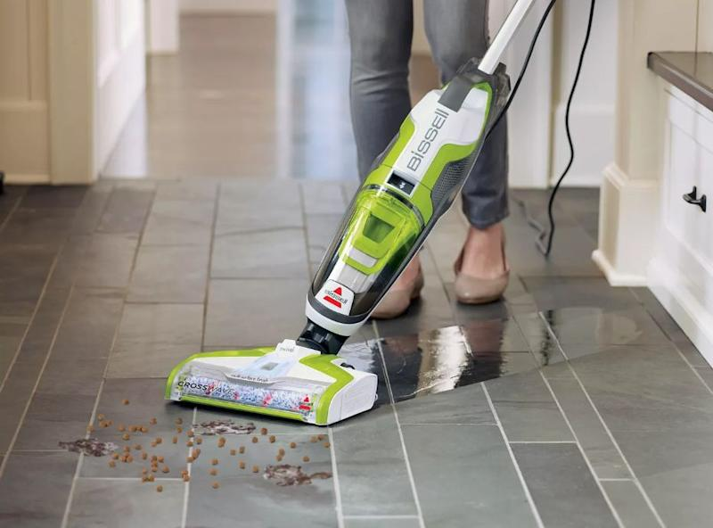 "You won't have to worry about washing and vacuuming your floors separately ever again. This Bissell vacuum has a cleaning system that lets you do both at the same time. <strong><a href=""https://fave.co/2CsTfR3"" target=""_blank"" rel=""noopener noreferrer"">Originally&nbsp;$270, get it for $200 at Target</a></strong>. (Photo: Target)"