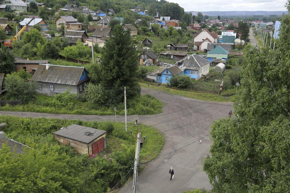 In this photo taken on Thursday, July 5, 2018, a view of the area where Russian star midfielder Alexander Golovin grew up, in Kaltan, Russia. When Russia plays at the World Cup, Kaltan looks like a ghost town. This remote Siberian coal-mining town is the home of Golovin, whose key role in Russia's run to the World Cup quarterfinals has made him a national hero. (AP Photo/Yaroslav Belyaev)