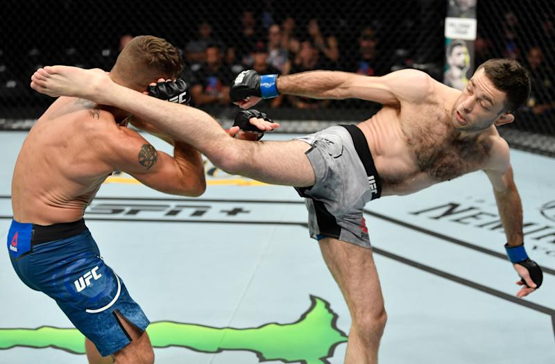 SACRAMENTO, CALIFORNIA - JULY 13: (R-L) Ryan Hall kicks Darren Elkins in their featherweight bout during the UFC Fight Night event at Golden 1 Center on July 13, 2019 in Sacramento, California. (Photo by Jeff Bottari/Zuffa LLC/Zuffa LLC via Getty Images)
