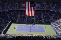 Belinda Bencic, of Switzerland, right, returns a shot to Jessica Pegula, of the United States, during the third round of the US Open tennis championships, Saturday, Sept. 4, 2021, in New York. (AP Photo/Seth Wenig)
