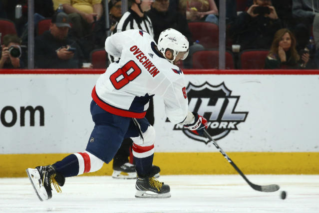 Washington Capitals left wing Alex Ovechkin shoots the puck against the Arizona Coyotes during the second period of an NHL hockey game Saturday, Feb. 15, 2020, in Glendale, Ariz. (AP Photo/Ross D. Franklin)