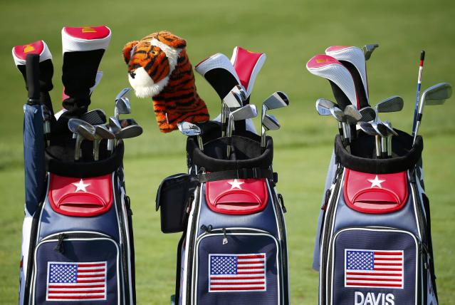 U.S. golfer Tiger Woods' golf bag is shown between those of fellow members of the U.S Team during the first practice round for the 2013 Presidents Cup golf tournament at Muirfield Village Golf Club in Dublin, Ohio October 1, 2013. REUTERS/Jeff Haynes (UNITED STATES - Tags: SPORT GOLF)