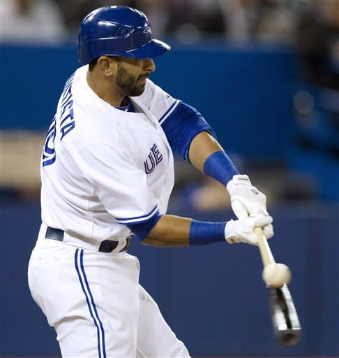 Toronto Blue Jays' Jose Bautista strikes out during the seventh inning of a baseball game against the Boston Red Sox in Toronto on Tuesday, April 10, 2012. (AP Photo/The Canadian Press, Frank Gunn)