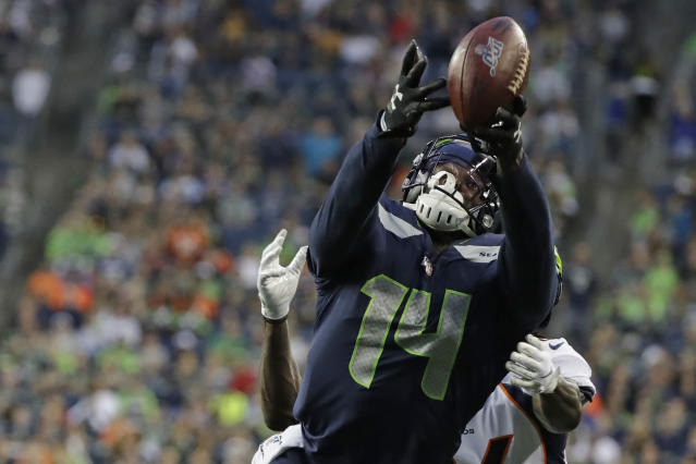 Seattle Seahawks wide receiver DK Metcalf reaches for an incomplete pass during the first half of the team's NFL football preseason game against the Denver Broncos on Thursday, Aug. 8, 2019, in Seattle. (AP Photo/Elaine Thompson)