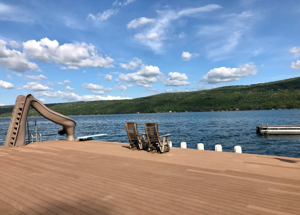 """<h2>Keuka Lake, New York<br></h2><br><strong>Location</strong>: Hammondsport, New York<br><strong>Sleeps</strong>: 4<br><strong>Price Per Night</strong>: <a href=""""https://airbnb.pvxt.net/BXnDz1"""" rel=""""nofollow noopener"""" target=""""_blank"""" data-ylk=""""slk:$280"""" class=""""link rapid-noclick-resp"""">$280</a><br><br>""""This private lake-front cottage has convenient drive-up parking and is in walking distance to the charming village of Hammondsport. The spacious one-of-a-kind permanent dock provides picturesque views of the sunrise, Keuka Lake, and surrounding foliage. Three kayaks, a water slide, fire-pit, & WiFi are on site. The interior of the cottage was completed renovated during the winter of 2020.""""<br><br><h3>Book <a href=""""https://airbnb.pvxt.net/BXnDz1"""" rel=""""nofollow noopener"""" target=""""_blank"""" data-ylk=""""slk:The Cottage On Keuka Lake"""" class=""""link rapid-noclick-resp"""">The Cottage On Keuka Lake</a><br></h3><br><br>"""