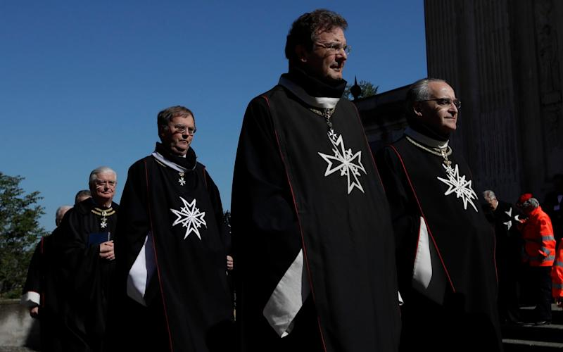 Albrecht von Boeselager, second from right, walks in procession along with other Knights of Malta before the election of the new Grand Master - Credit:  Alessandra Tarantino/AP
