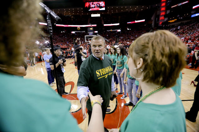 Houston Rockets owner Tilman Fertitta greets members on the Santa Fe High School choir who sang the national anthem before Game 5 of the NBA basketball playoffs Western Conference finals between the Houston Rockets and the Golden State Warriors, Thursday, May 24, 2018, in Houston. Ten people were killed in shootings at the school last week. (AP Photo/David J. Phillip)
