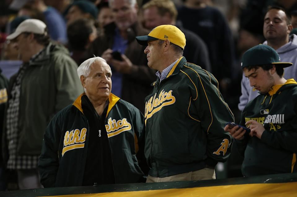 A changing of the guard within the A's ownership: Lew Wolff (left) is out as managing partner and John Fisher (right) is in. (Getty Images)
