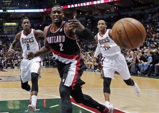 Portland Trail Blazers' Wesley Matthews (2) loses the ball in front of Milwaukee Bucks' Larry Sanders (8) and Monta Ellis during the first half of an NBA basketball game Tuesday, March 19, 2013, in Milwaukee. (AP Photo/Morry Gash)