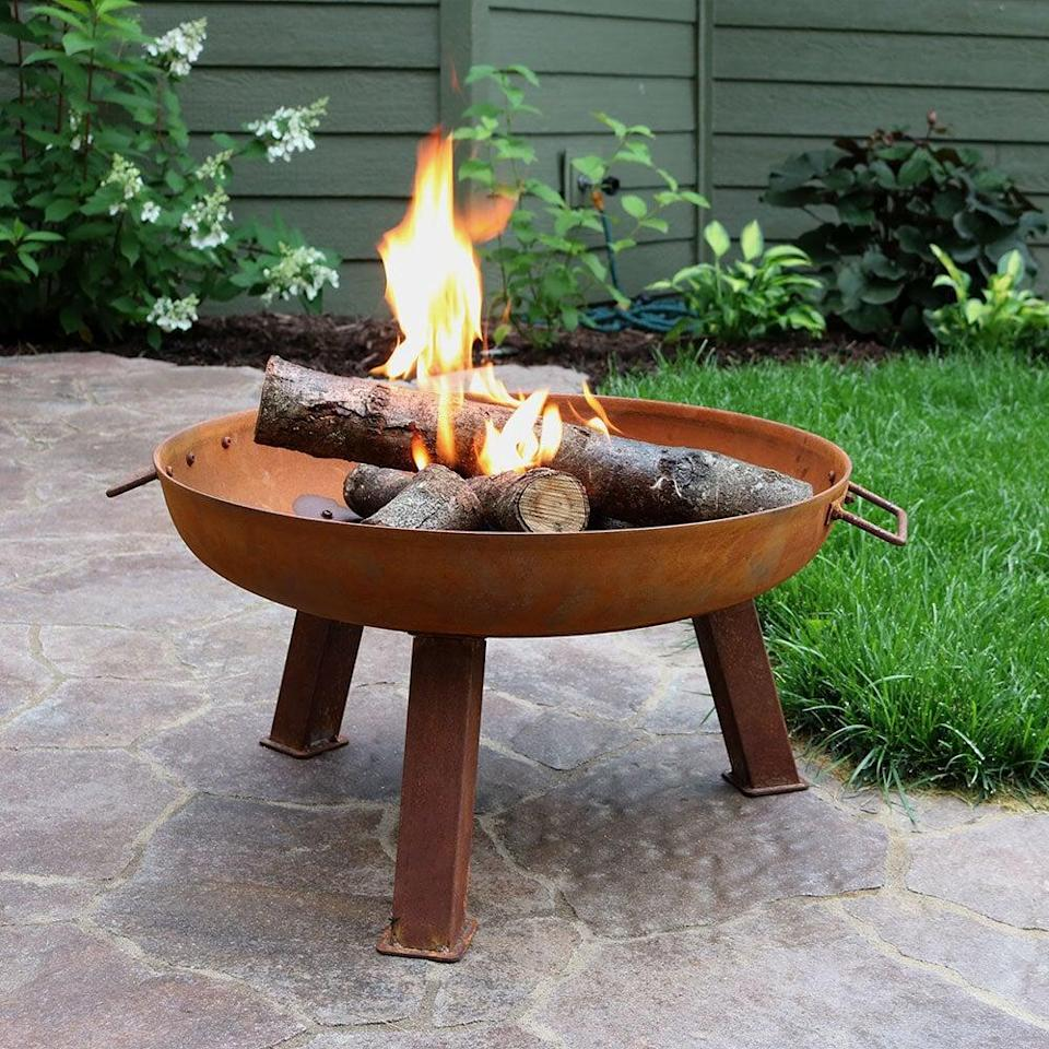 <p>This <span>Tidworth Bowl Cast Iron Wood Burning Fire Pit</span> ($96, originally $137) will give your yard a golden glow.</p>