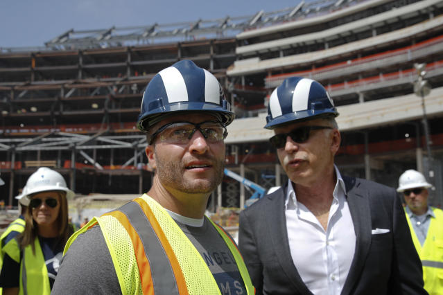 Los Angeles Rams owner Stan Kroenke, right, and head coach Sean McVay tour the team's new NFL football stadium Thursday, June 14, 2018, in Inglewood, Calif. McVay scrapped the final practice of minicamp and took his players and coaches on a tour of their multibillion-dollar stadium, which will open for the 2020 season. (AP Photo/Jae C. Hong)