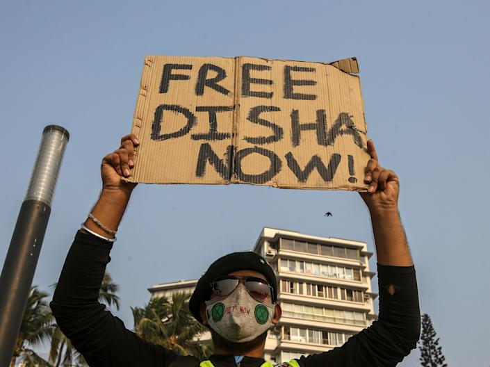 <p>A protester demands the release of climate activist Disha Ravi after her arrest by the Delhi police in connection with a toolkit shared by Greta Thunberg </p> (EPA)
