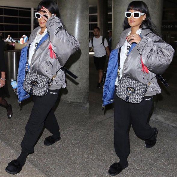 <p>In a grey puffy coat, white sunglasses, sweatpants, socks, and sandals at LAX after her trip to Japan. </p>