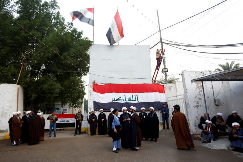 Supporters of Iraqi Shi'ite cleric Moqtada al-Sadr are seen near his home, after it was attacked, in the holy city of Najaf