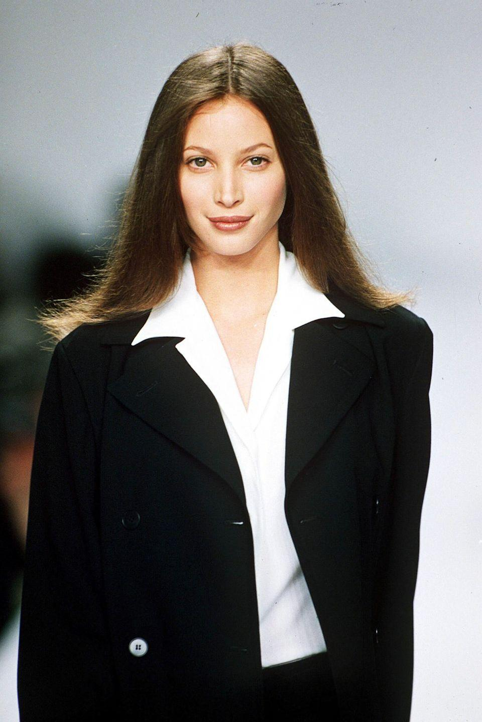 """<p>Along with Evangelista and Campbell, Turlington rounded out what the fashion industry coined the """"Holy Trinity."""" Born in Oakland, California, she started modeling locally in Florida. But it was not until moving to New York at 18 when her dominance at the top of the modeling world solidified. Over the years, Turlington left to get an education, graduating cum laude from the Columbia University Mailman School of Public Health. She now focuses her efforts on Every Mother Counts, an organization that, according to its mission statement, """"make pregnancy and childbirth safe for every mother, everywhere.""""</p>"""