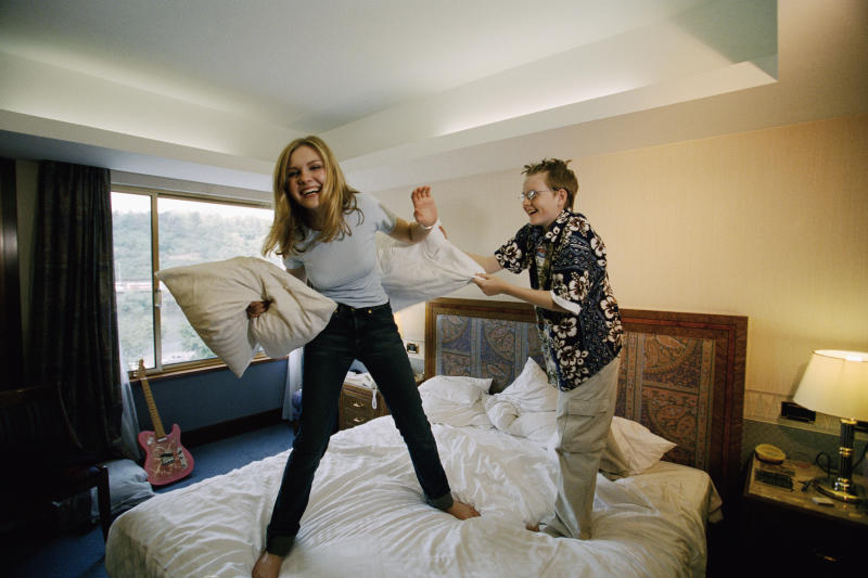 Actress Kirsten Dunst has a pillow fight with her younger brother Christian in a hotel room in Prague. The American actress is in town filming the Reverge Anselmo romance All Forgotten. (Photo by © Patrick Robert/Sygma/CORBIS/Sygma via Getty Images)