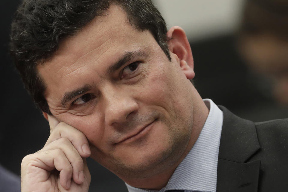 FILE - In this July 2, 2019 file photo, Brazil's Justice Minister Sergio Moro smiles during his testimony before a House Commission, in Brasilia, Brazil. Press reports have accused Moro of allegedly coordinating with prosecutors, improperly advising them in a case against former President Luiz Inácio Lula da Silva. Moro and prosecutors deny any wrongdoing. (AP Photo/Eraldo Peres, File)