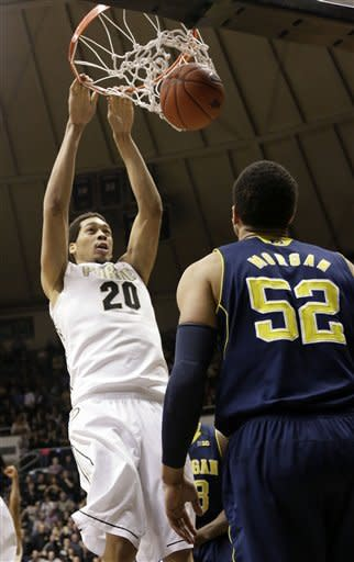 Purdue center A.J. Hammons (20) dunks in front of Michigan forward Jordan Morgan (52) during the first half of an NCAA college basketball game on Wednesday, March 6, 2013, in West Lafayette, Ind. (AP Photo/AJ Mast)