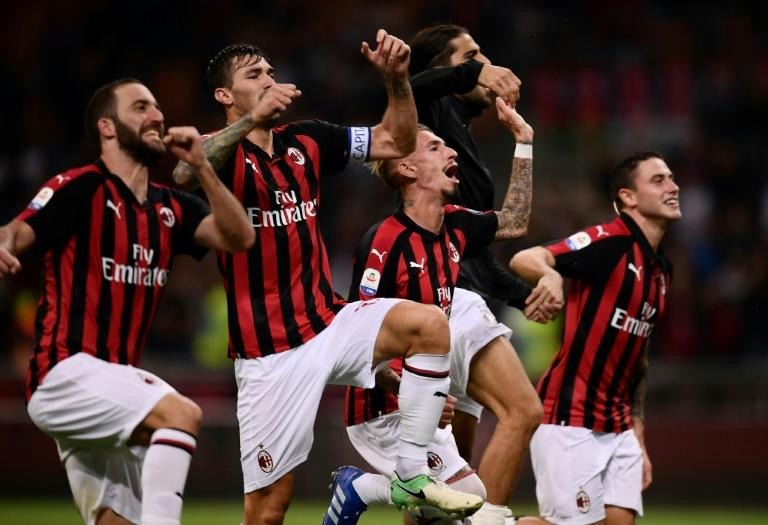 AC Milan's players celebrate after last-gasp Patrick Cutrone goal seals 2-1 Serie A win over AS Roma