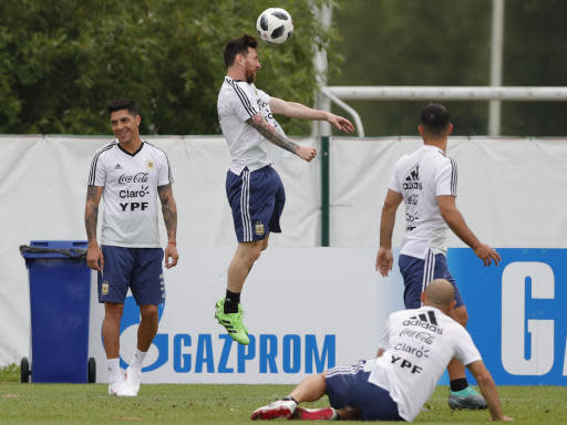 Lionel Messi heads the ball during a training session of Argentina at the 2018 soccer World Cup in Bronnitsy, Russia, Tuesday, June 19, 2018. (AP Photo/Ricardo Mazalan)