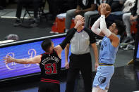 Memphis Grizzlies forward Dillon Brooks, right, shoots against Chicago Bulls guard Ryan Arcidiacono during the second half of an NBA basketball game in Chicago, Friday, April 16, 2021. (AP Photo/Nam Y. Huh)