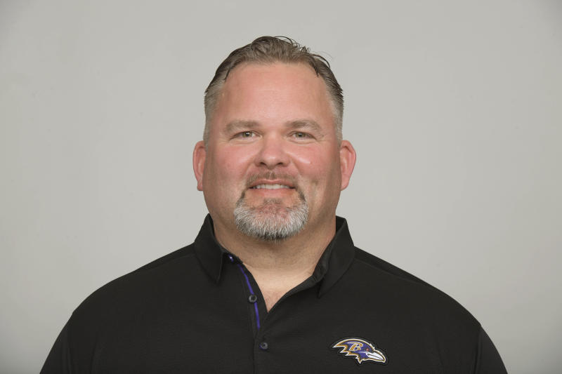 File-This July 12, 2019, photo shows Greg Roman of the Baltimore Ravens NFL football team. The mastermind behind the Baltimore Ravens' prolific offense may be headed elsewhere after the team has completed its playoff run. Coach John Harbaugh confirmed Monday, Dec. 30, 2019, that the Cleveland Browns have asked permission to talk to Roman about their vacant head coaching job, and the Ravens will allow that interview to take place. Harbaugh suspects the interview could occur this week, because top-seeded Baltimore has a bye before opening the playoffs on Jan. 11. (AP Photo/File)