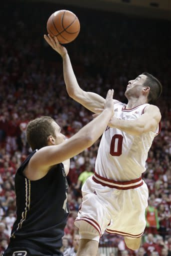 Indiana forward Will Sheehey, right, hits a shot over Purdue guard D.J. Byrd in the second half of a NCAA college basketball game in Bloomington, Ind., Saturday, Feb. 16, 2013. Indiana defeated Purdue 83-55. (AP Photo/Michael Conroy)