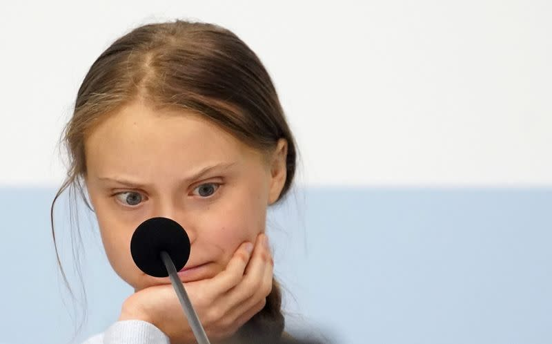 Climate change activist Greta Thunberg reacts during a news conference during COP25 climate summit in Madrid