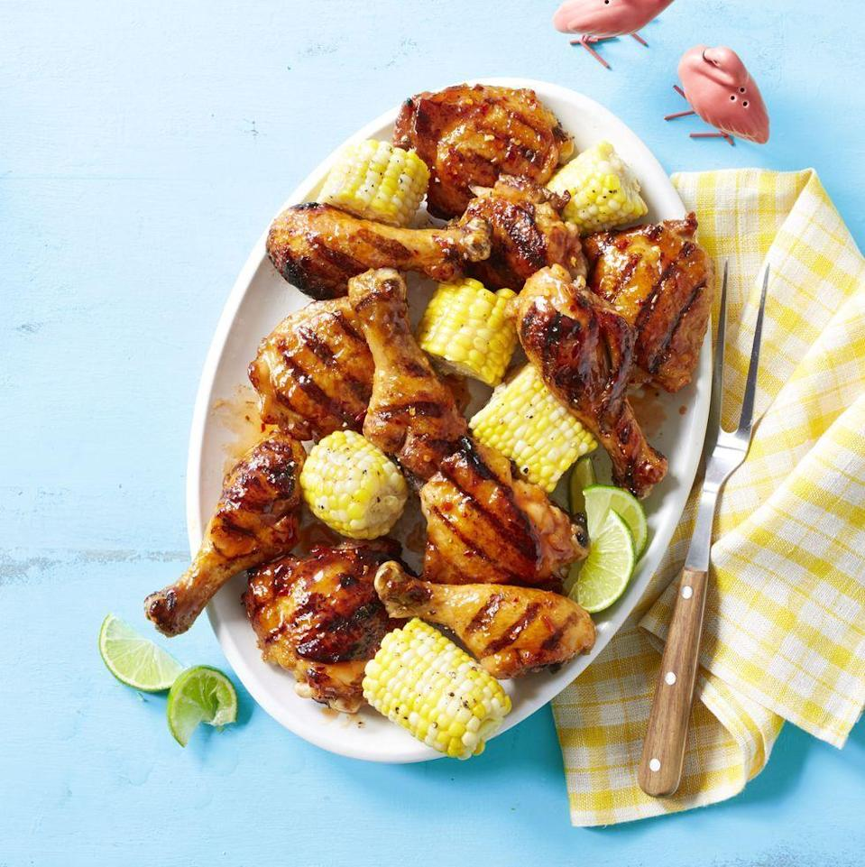 "<p>This zesty chicken dish only takes half an hour to make and it's sweet and spicy goodness will quickly make it a family favorite. </p><p><strong><em><a href=""https://www.womansday.com/food-recipes/a32884262/apricot-glazed-chicken-and-corn-recipe/"" rel=""nofollow noopener"" target=""_blank"" data-ylk=""slk:Get the Apricot-Glazed Chicken and Corn recipe."" class=""link rapid-noclick-resp"">Get the Apricot-Glazed Chicken and Corn recipe. </a></em></strong></p>"