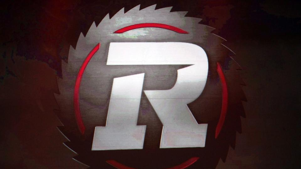 The new logo for the Ottawa RedBlacks is displayed on a screen at an event to announce the name and logo for the new Ottawa CFL football franchise in Ottawa on Saturday, June 8, 2013. THE CANADIAN PRESS/ Patrick Doyle