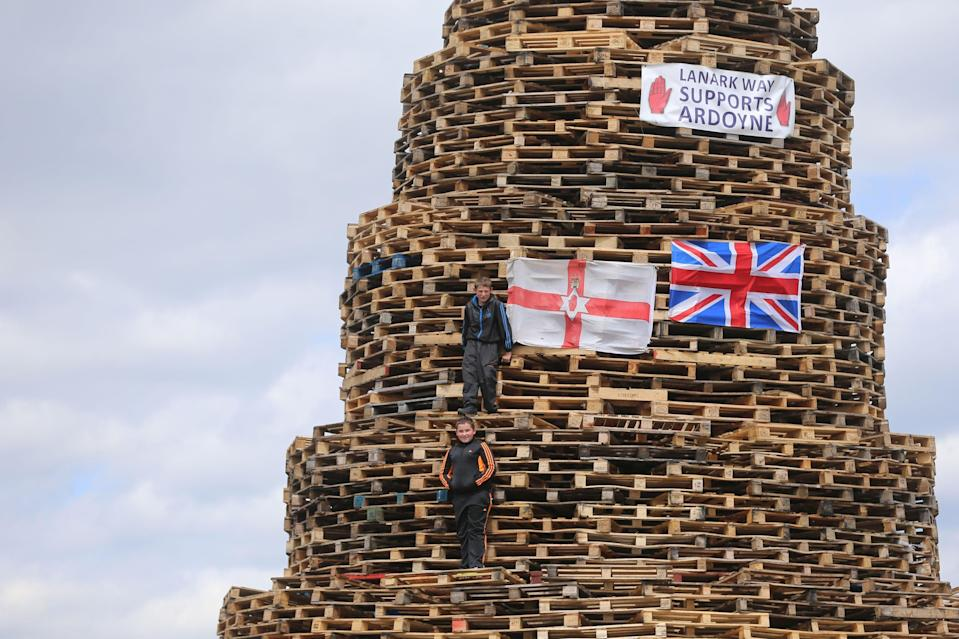 Bonfire builders in the New Mosley area of Belfast (PA Archive)