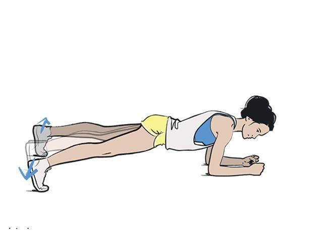 <p><strong>1/ </strong>You know the drill – get planking.</p><p><strong>2/ </strong>Jump your legs wide and then back together as fast as you can. Keep your hips steady and don't let your bum rise.</p>