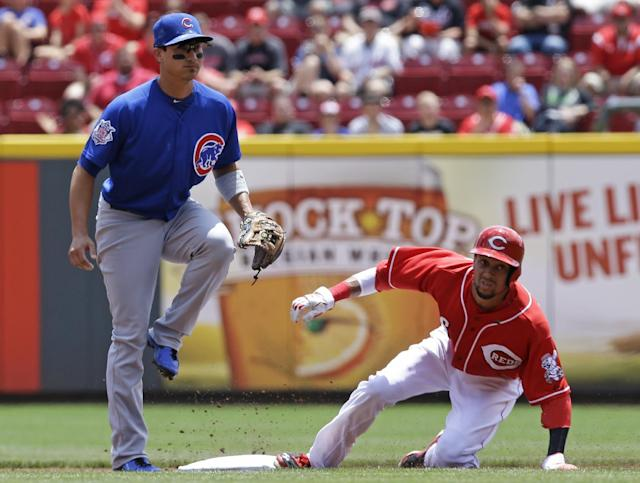 Cincinnati Reds' Billy Hamilton, right, steals second base as Chicago Cubs second baseman Darwin Barney waits for the throw in the first inning of a baseball game, Tuesday, July 8, 2014, in Cincinnati. (AP Photo/Al Behrman)