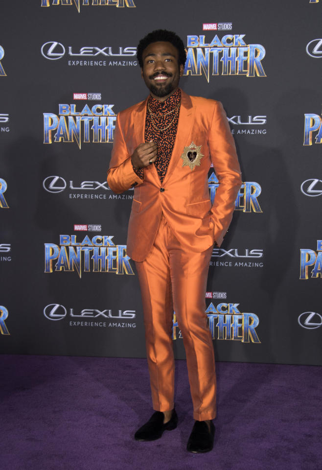 <p>Wearing a satin, tangerine suit. <em>[Photo: Getty]</em> </p>
