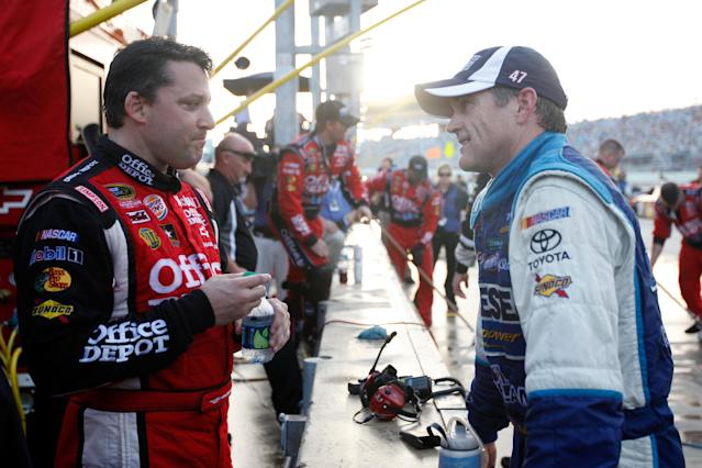 HOMESTEAD, FL - NOVEMBER 20: (L-R) Tony Stewart, driver of the #14 Office Depot/Mobil 1 Chevrolet, and Bobby Labonte, driver of the #47 Reese Towpower Toyota, talk during the reg flag rain delay during the NASCAR Sprint Cup Series Ford 400 at Homestead-Miami Speedway on November 20, 2011 in Homestead, Florida. (Photo by Chris Graythen/Getty Images)