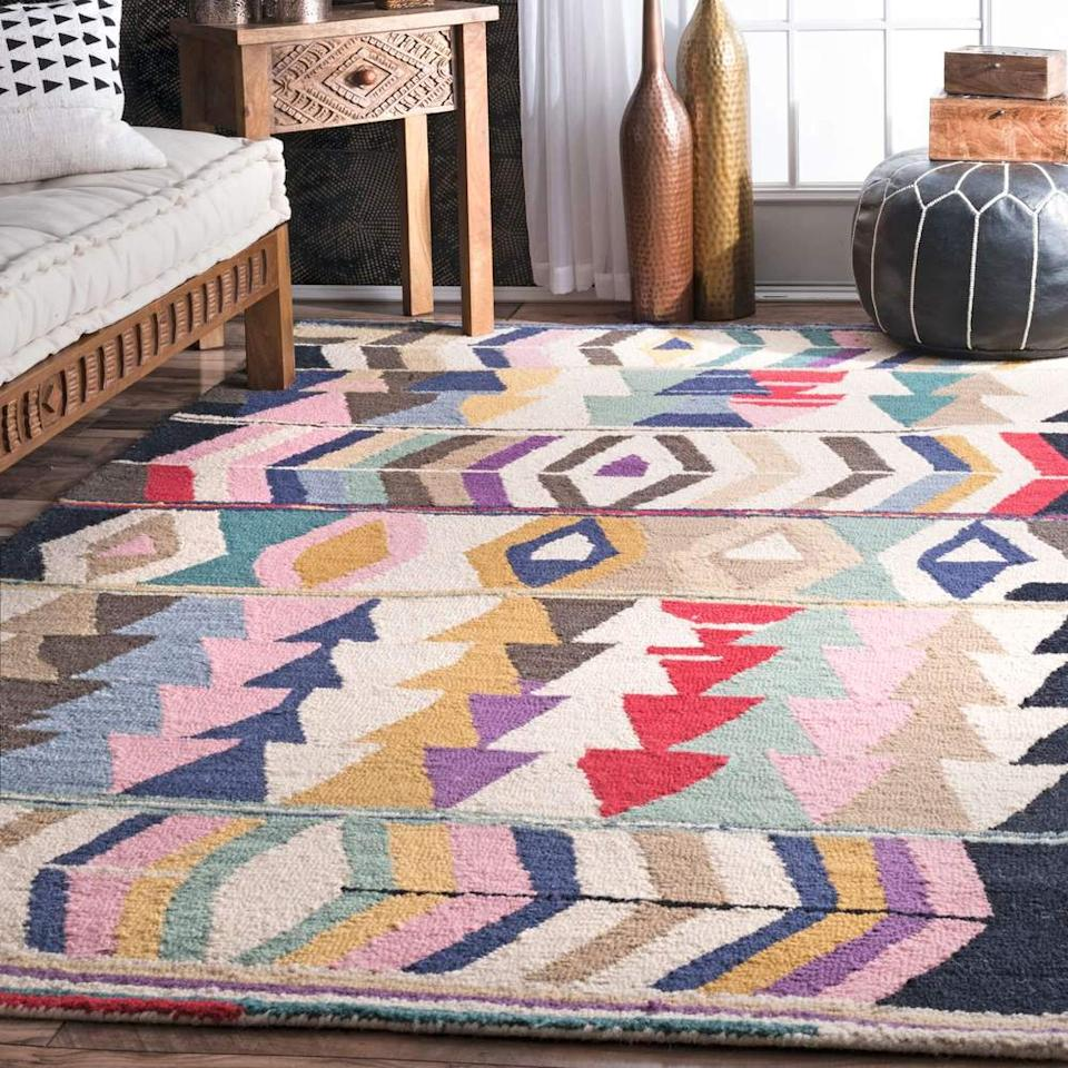 """<h3><a href=""""https://www.allmodern.com/rugs/pdp/foti-hand-tufted-pinkbeige-area-rug-bngl7314.html"""" rel=""""nofollow noopener"""" target=""""_blank"""" data-ylk=""""slk:AllModern Foti Hand-Tufted Rug"""" class=""""link rapid-noclick-resp"""">AllModern Foti Hand-Tufted Rug</a></h3><br>This hand-tufted, geometric-patterned area rug topped readers' top <a href=""""https://refinery29.com/en-us/the-score-best-home-sales"""" rel=""""nofollow noopener"""" target=""""_blank"""" data-ylk=""""slk:home-sale shopping lists"""" class=""""link rapid-noclick-resp"""">home-sale shopping lists</a> in January as one vibrant way to warm up their winter spaces. <br><br><strong>Bungalow Rose</strong> Foti Hand-Tufted Pink/Beige Area Rug, $, available at <a href=""""https://www.allmodern.com/rugs/pdp/bungalow-rose-foti-hand-tufted-pinkbeige-area-rug-bngl7314.html"""" rel=""""nofollow noopener"""" target=""""_blank"""" data-ylk=""""slk:AllModern"""" class=""""link rapid-noclick-resp"""">AllModern</a>"""