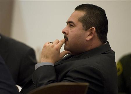 Former Fullerton police officer Ramos sits during his trial in Santa Ana