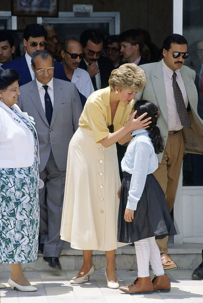 Diana embraces 10-year-old Heba Salah while visiting the Institute for Polio Rehabilitation in Cairo, Egypt.