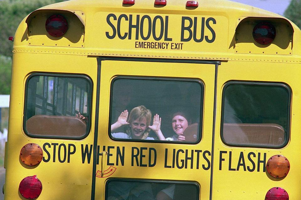 """<p>Two students have a bit of fun looking out the back window of their bus on the way home from the first day of school.</p><p><strong>RELATED: </strong><a href=""""https://www.goodhousekeeping.com/childrens-products/g1316/cute-school-supplies/"""" rel=""""nofollow noopener"""" target=""""_blank"""" data-ylk=""""slk:30 Cute School Supplies Your Kids Will Love"""" class=""""link rapid-noclick-resp"""">30 Cute School Supplies Your Kids Will Love</a></p>"""