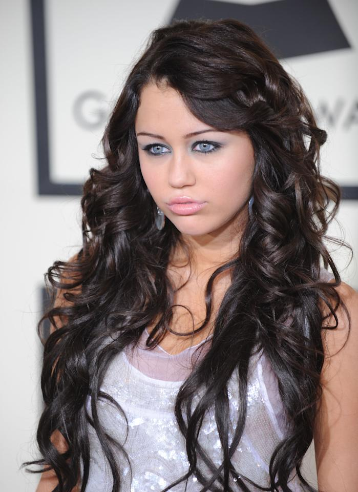 <b>#19.</b> 2008 may as well be known as the birth of Miley's duck face. It's been five years since she's perfected her red carpet photo-ready face, but back then her look was all about extensions down to her hips and dark, dark hair.