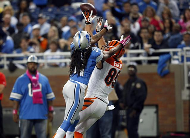 Cincinnati Bengals tight end Tyler Eifert (85) catches a 32-yard touchdown reception as Detroit Lions cornerback Rashean Mathis (31) defends in the third quarter of an NFL football game on Sunday, Oct. 20, 2013, in Detroit. (AP Photo/Rick Osentoski)