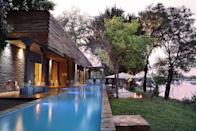 """<p>This five-star private reserve offers the ultimate in luxury lodging for adventure-seekers and is seated next to the largest waterfall on the planet. <a href=""""https://matetsivictoriafalls.com/"""" rel=""""nofollow noopener"""" target=""""_blank"""" data-ylk=""""slk:Matetsi Victoria Falls"""" class=""""link rapid-noclick-resp"""">Matetsi Victoria Falls</a> features 22 suites, conservation-minded guides, local artistry, and 136,000 pristine acres of protected wilderness. Besides one-of-kind experiences, the property also boasts fantastic wellness and gastronomy. There's also an opportunity for exclusive and part-exclusive buyouts.</p><p>""""Known as the Mosi Oa Tunya, or 'smoke that thunders,' in the local language, the Victoria Falls are one of the most incredible waterfalls to be seen,"""" says award-winning Reco travel advisor Duncan Greenfield-Turk. """"Matets,i is a mere 30 to 40 minutes away from the falls and offers an absolute escape with the opportunity to reconnect to nature while feasting on the most incredible cuisine.""""</p>"""