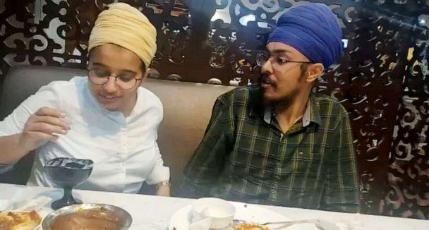 PHOTO: Newlyweds Paramjyot Kaur and Ishaan Singh, of Punjab, have been volunteering at a makeshift clinic in New Delhi. (Handout)