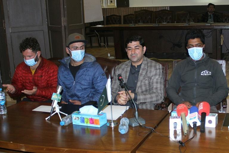Local tourism official Raja Nasir Ali Khan (2R) spoke to reporters with Sajid Ali Sadpara (R), the son of missing Pakistani climber Muhammad Ali Sadpara and relatives (on left side) of Chilean climber Juan Pablo Mohr, in Skardu, Pakistan